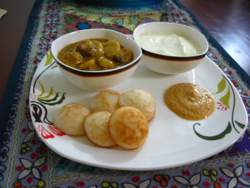 Paniyaram with Poricha Kuzhambu, Green Tomato Chutney and Curd